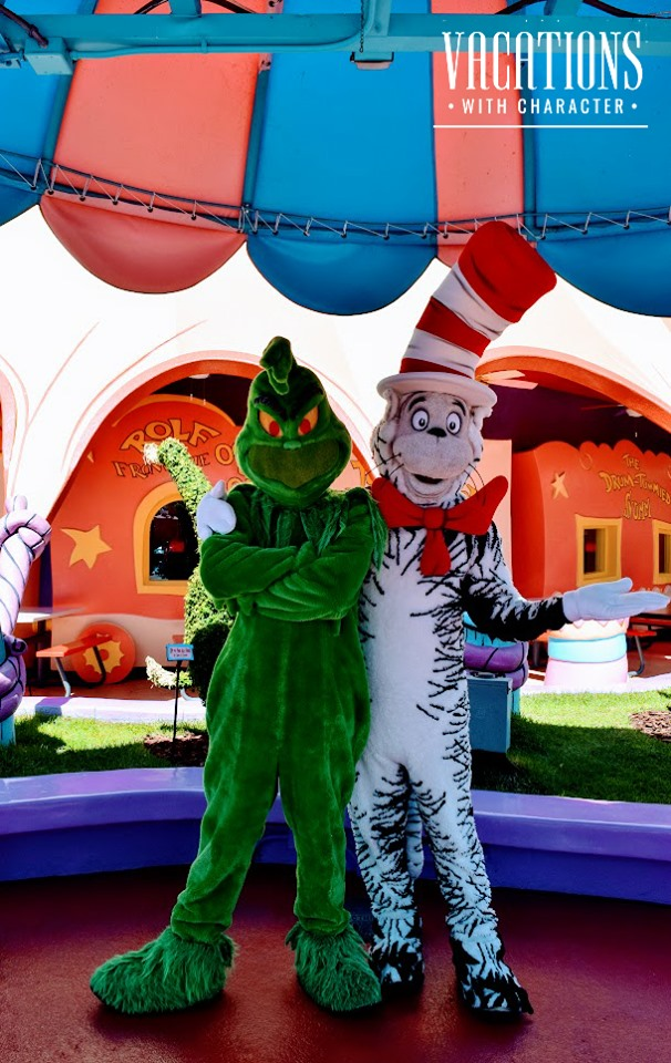 The Grinch and The Cat in the Hat pose for a photo op